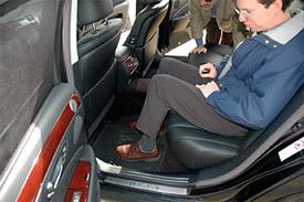 Ward's AutoWorld editors Tom Murphy and Drew Winter find ample leg room in Lexus LS 460 L.