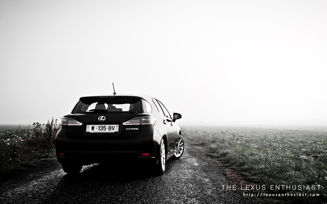 Black Lexus CT 200h in Paris Rear Fog