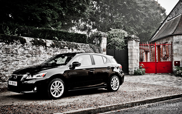 Black Lexus CT 200h with Red Fence